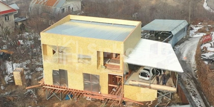 Строительство каркасного дома на склоне горы в Ремизовке, 216 кв.м